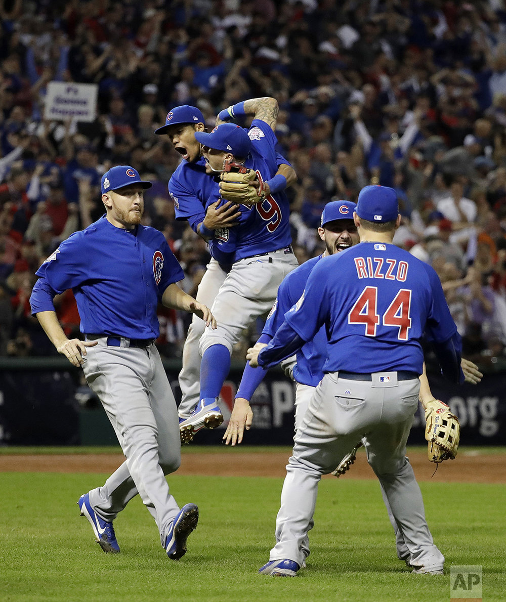 The Chicago Cubs celebrate after Game 7 of the Major League Baseball World Series against the Cleveland Indians on Nov. 3, 2016, in Cleveland. The Cubs won 8-7 in 10 innings to win the series 4-3. (AP Photo/David J. Phillip)