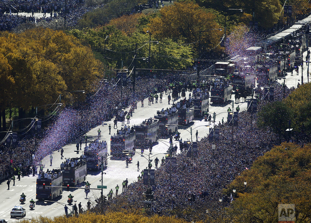 Fans line the route for a parade honoring the World Series champion Chicago Cubs baseball team in Chicago on Nov. 4, 2016. (AP Photo/Kiichiro Sato)