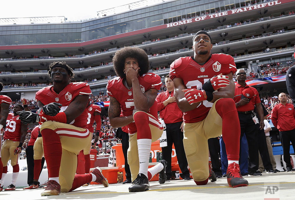 San Francisco 49ers outside linebacker Eli Harold, left, quarterback Colin Kaepernick, center, and safety Eric Reid kneel during the national anthem before an NFL football game against the Dallas Cowboys in Santa Clara, Calif., on Oct. 2, 2016. (AP Photo/Marcio Jose Sanchez)