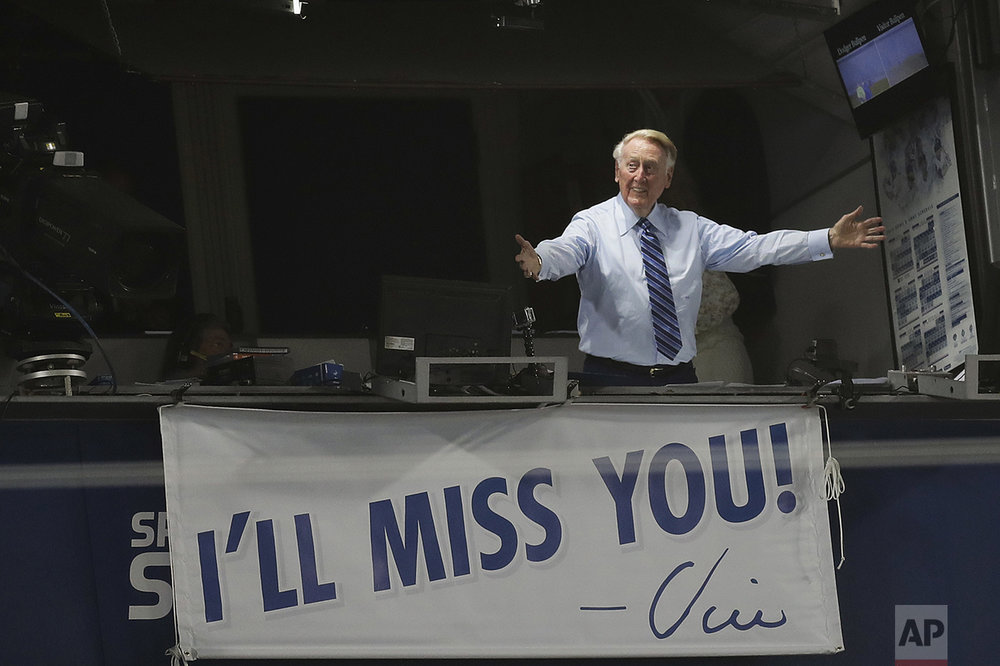 Los Angeles Dodgers broadcaster Vin Scully gestures in his booth during a baseball game between the Los Angeles Dodgers and the Colorado Rockies on Sept. 23, 2016, in Los Angeles. Scully retired in 2016. (AP Photo/Jae C. Hong)