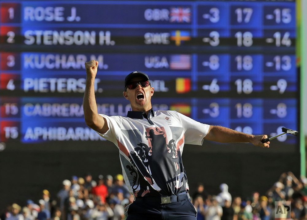 Justin Rose, of Great Britain, wins the gold medal during the final round of the men's golf event at the 2016 Summer Olympics in Rio de Janeiro, Brazil, on Aug. 14, 2016. (AP Photo/Chris Carlson)