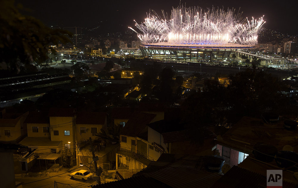 Fireworks explode above the Maracana stadium during the opening ceremony of the 2016 Summer Olympics in Rio de Janeiro, Brazil, on Aug. 5, 2016. (AP Photo/Leo Correa)