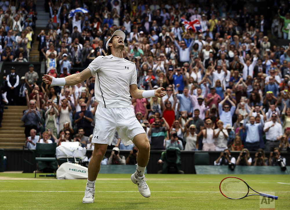 Andy Murray of Britain celebrates after beating Milos Raonic of Canada in the men's singles final on the fourteenth day of the Wimbledon Tennis Championships in London on July 10, 2016. (AP Photo/Kirsty Wigglesworth)