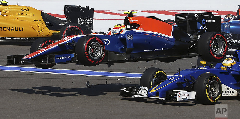 Manor driver Rio Haryanto of Indonesia flies over Sauber driver Marcus Ericsson of Sweden during an accident at the start of the Formula One Russian Grand Prix at the Sochi Autodrom racetrack in Sochi, Russia, on May 1, 2016.(AP Photo/Denis Tyrin)