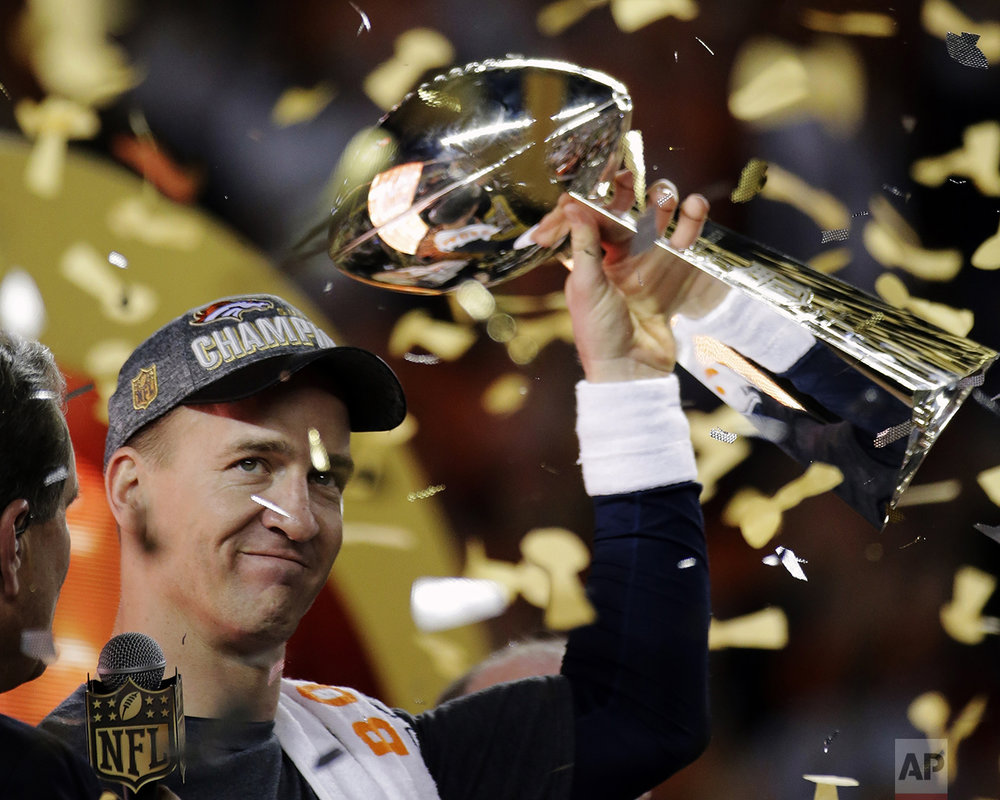 Denver Broncos' Peyton Manning holds up the trophy after the NFL Super Bowl 50 football game on Feb. 7, 2016, in Santa Clara, Calif. The Broncos won 24-10. (AP Photo/Matt York)
