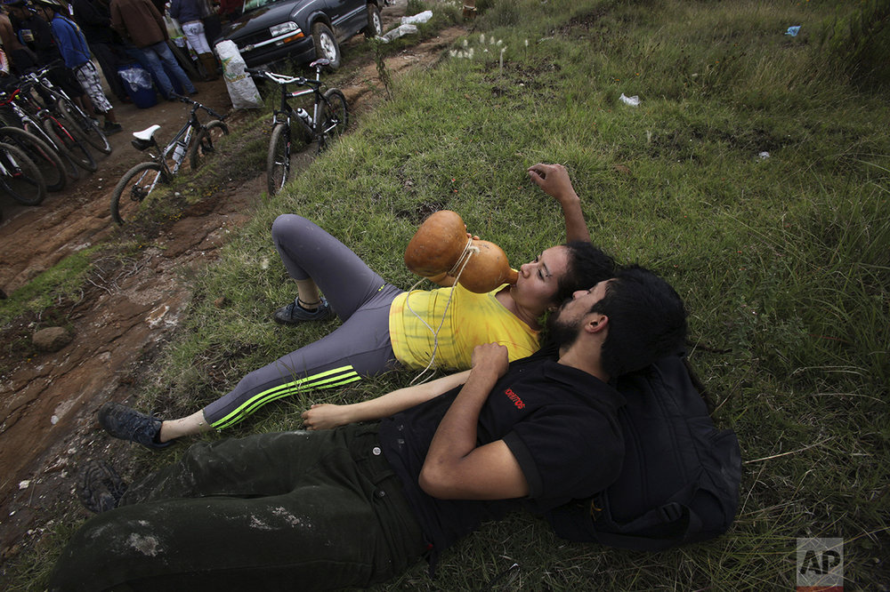 "In this Nov. 20, 2016 photo, a woman drinks pulque from a gourd canteen, during a pulque festival in Santiago Cuautlalpan, Mexico. ""Before, drinking pulque was looked down on, people would say, ""Oh, no, drinking pulque is really low class,"" said Carlos Eladio, a festival organizer. (AP Photo/Marco Ugarte)"