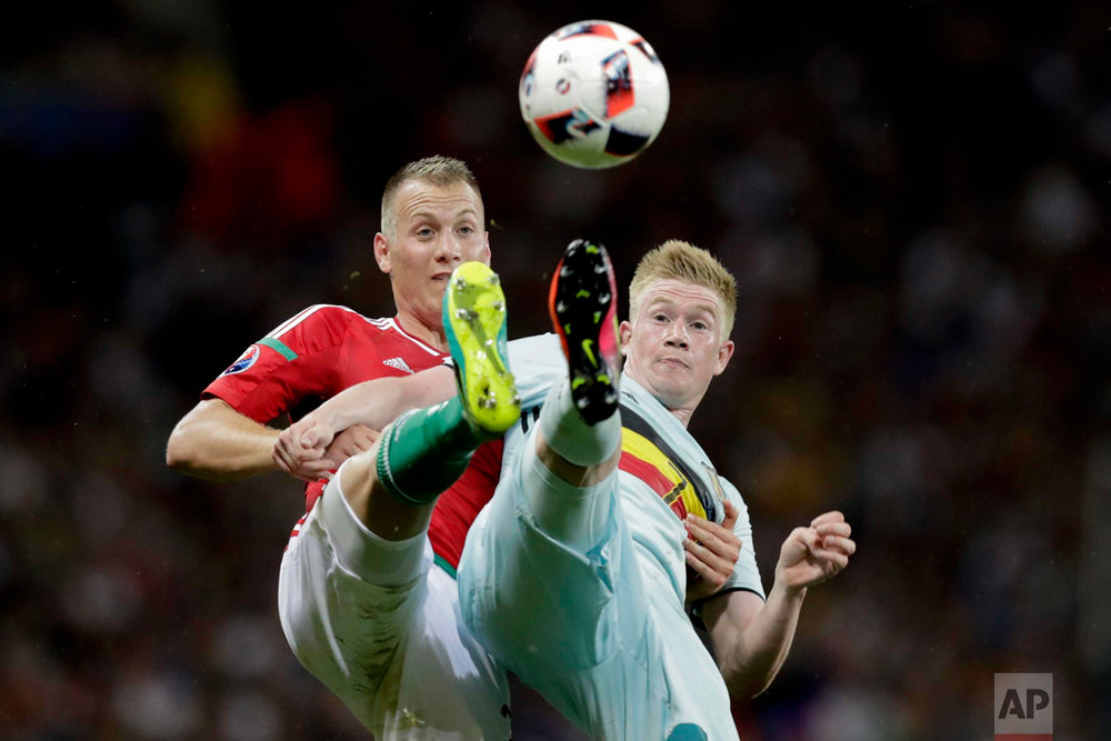 In this Sunday, June 26, 2016 photo, Belgium's Kevin De Bruyne, right, fights for the ball with Hungary's Adam Lang during the Euro 2016 round of 16 soccer match between Hungary and Belgium, at the Stadium municipal in Toulouse, France. (AP Photo/Ariel Schalit)