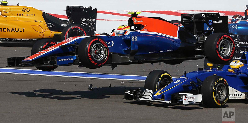 In this Sunday, May 1, 2016 photo, Manor driver Rio Haryanto of Indonesia flies over Sauber driver Marcus Ericsson of Sweden during an accident at the start of the Formula One Russian Grand Prix at the Sochi Autodrom racetrack in Sochi, Russia.(AP Photo/Denis Tyrin)