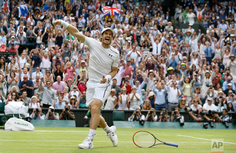 In this Sunday, July 10, 2016 photo, Andy Murray of Britain celebrates after beating Milos Raonic of Canada in the men's singles final on day fourteen of the Wimbledon Tennis Championships in London. (AP Photo/Kirsty Wigglesworth)