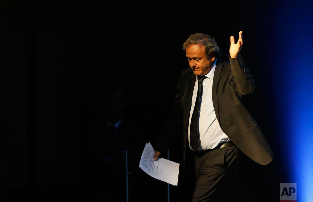 In this Wednesday, Sept. 14, 2016 photo, former UEFA President Michel Platini waves after his speech during the vote for the new UEFA president a in Athens. European soccer federations will elect Wednesday a new UEFA president to replace Michel Platini, who is serving a four-year ban from the sport. (AP Photo/Thanassis Stavrakis)