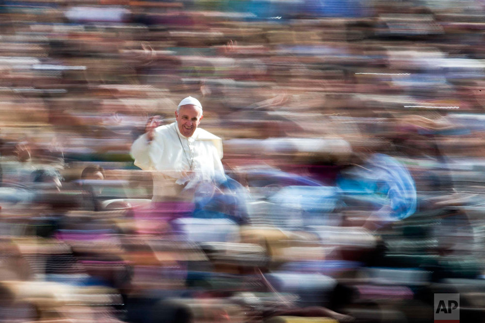 In this Wednesday, April 6, 2016 photo, Pope Francis waves to the crowd as he arrives on his pope-mobile for his weekly general audience, in St. Peter's Square at the Vatican. (AP Photo/Andrew Medichini)