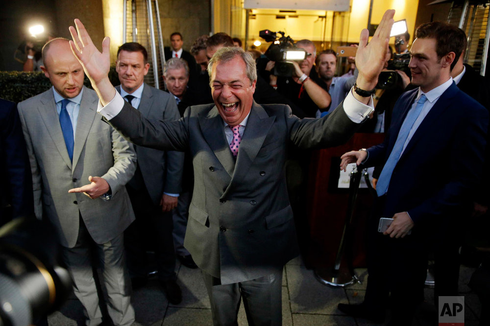 "In this Friday, June 24, 2016 photo, Nigel Farage, the leader of the UK Independence Party, celebrates as he poses for photographers as he leaves a ""Leave.EU"" organization party for the British European Union membership referendum in London. The British people voted by 52% in favour of leaving the European Union in the referendum on June 23. (AP Photo/Matt Dunham)"