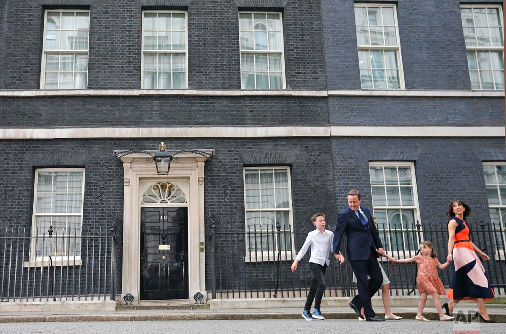 In this Wednesday, July 13, 2016 photo, Britain's Prime Minister David Cameron, his wife Samantha and their children Nancy, centre, Florence and Elwen, left, leave 10 Downing Street, in London. Cameron will formally resign during a meeting with Queen Elizabeth II at Buckingham Palace, then Theresa May, the Home Secretary, will take over. (AP Photo/Frank Augstein)