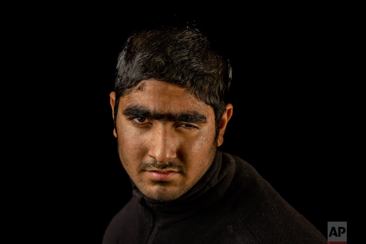 In this Nov. 29, 2016 photo, Faisal Ahmad poses for a portrait in the village of Karimabad, Indian-controlled Kashmir. Metal pellets shot by Indian security forces wounded Faisal during a raid in his village, losing eyesight on his left eye. The most recent protests erupted in early July after Indian troops killed Burhan Wani, a young and charismatic militant commander and sparked off more than five months of angry street protests in the Kashmir valley. (AP Photo/Bernat Armangue)