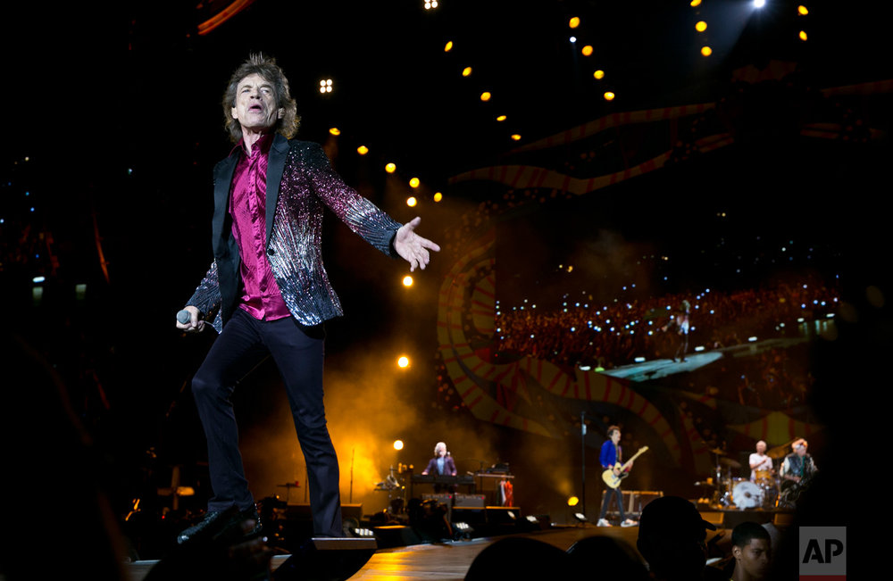 In this March 25, 2016 photo, Rolling Stones frontman Mick Jagger performs in Havana, Cuba. The Stones unleashed two hours of shrieking, thundering rock and roll on an ecstatic crowd of hundreds of thousands of Cubans and foreign visitors, capping one of the most momentous weeks in modern Cuban history with a massive celebration of music that was once forbidden here. The week opened with the arrival of President Barack Obama in Air Force One. (AP Photo/Enric Marti)
