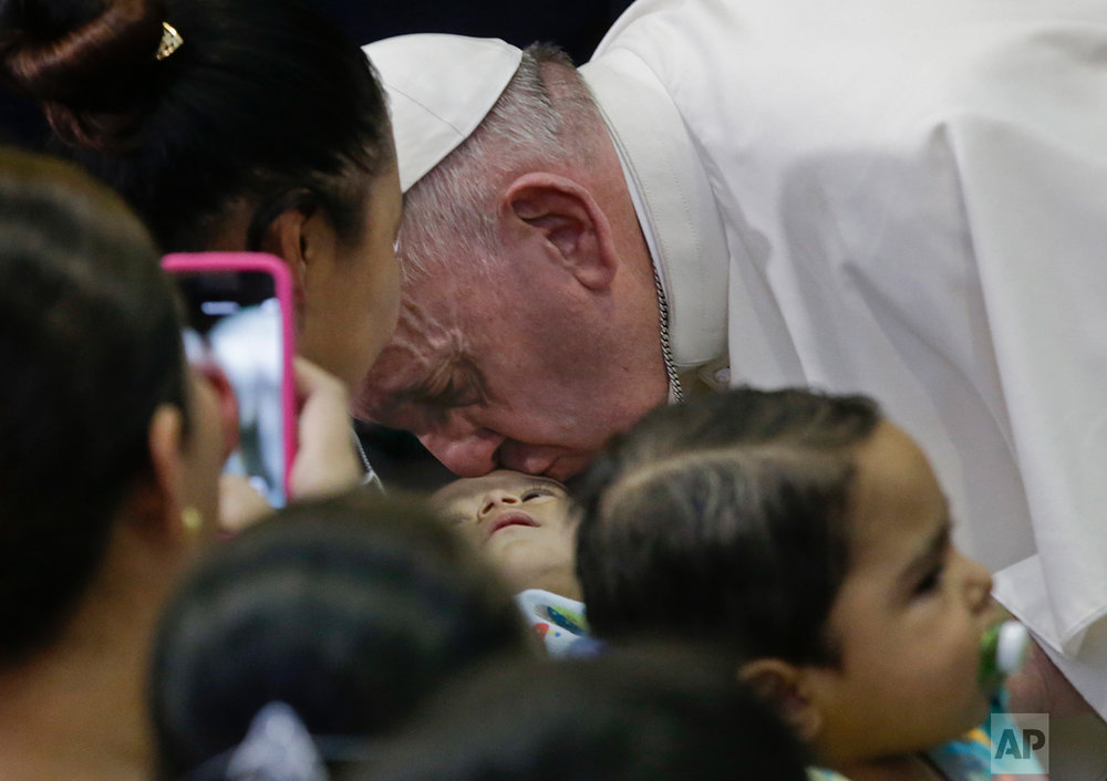 In this Feb. 14, 2016 photo, Pope Francis kisses a child on the forehead during his visit to the Federico Gomez Pediatric Hospital, in Mexico City. History's first Latin American pope traveled to Mexico in February for a weeklong tour. The highlight of the trip came on the final day, when Francis traveled to Ciudad Juarez and prayed at Mexico's northern border for all who have died trying to cross. (AP Photo/Gregorio Borgia)
