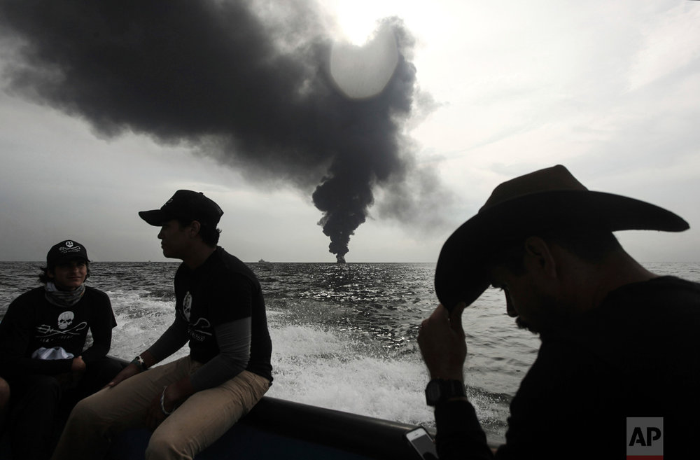 In this Sept. 25, 2016 photo, members of the marine wildlife conservation organization Sea Shepherd monitor the fuel tanker Burgos, as it continues to burn a day after it erupted in flames off the coast of the port city of Boca del Rio, Mexico. The tanker carrying gasoline and diesel off Mexico's Gulf coast was put out a day after the blaze began. (AP Photo/Felix Marquez)