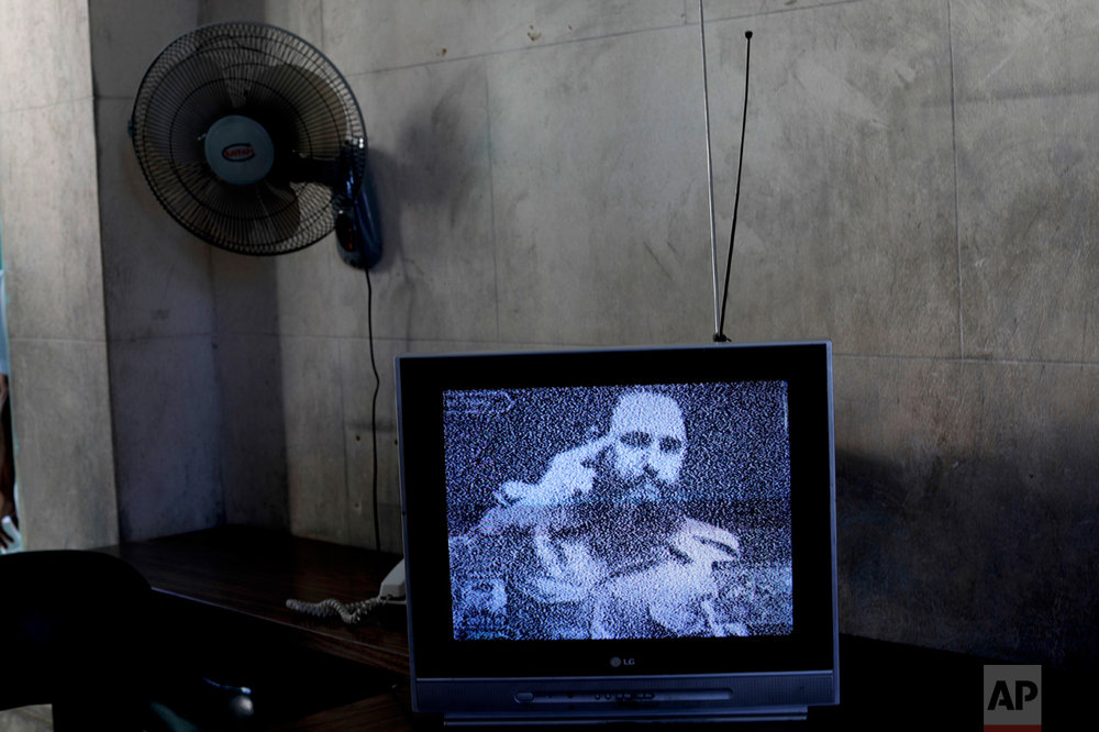 "This Nov. 29, 2016 photo shows a television broadcasting black and white footage of Fidel Castro delivering a speech at a memorial in his honor in Guanabacoa on the outskirts of Havana, Cuba. With a shaking voice, President Raul Castro said on state television that his older brother died at 10:29 p.m. Friday, Nov. 25. He ended the announcement by shouting the revolutionary slogan: ""Toward victory, always!"" (AP Photo/Natacha Pisarenko)"