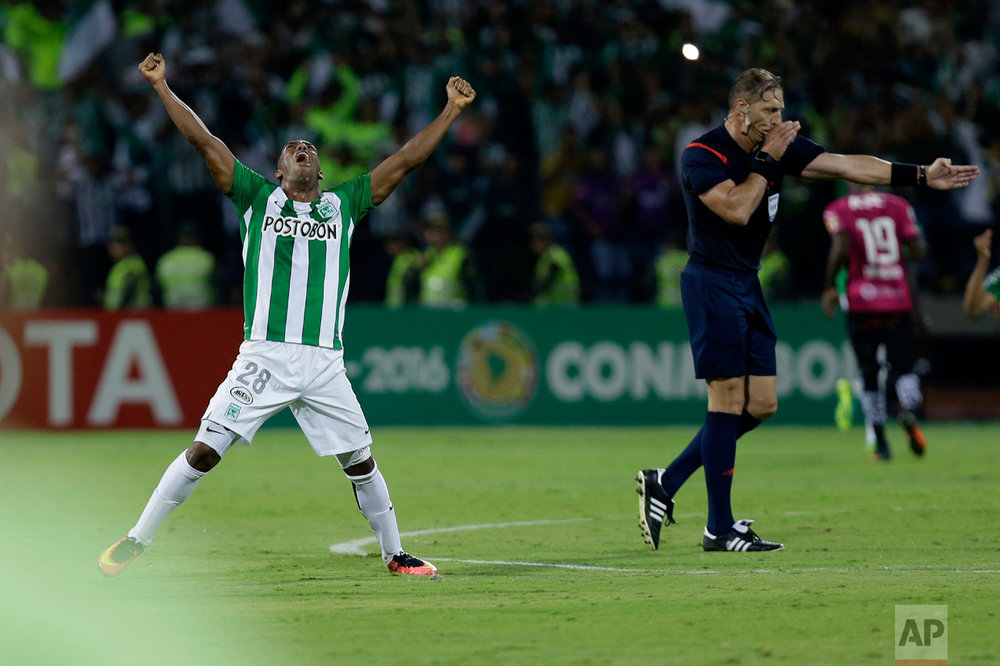 In this July 27, 2016 photo, Orlando Berrio of Colombia's Atletico Nacional reacts as referee Nestor Pitana of Argentina ends the Copa Libertadores final soccer match against Ecuador's Independiente del Valle in Medellin, Colombia. Atletico defeated Independiente and proclaimed themselves champions.(AP Photo/Fernando Vergara)