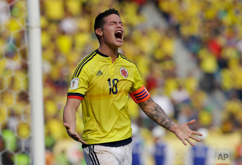 In this March 29, 2016 photo, Colombia's James Rodriguez reacts after missing a chance to score during the 2018 World Cup qualifying soccer match against Ecuador, in Barranquilla, Colombia. Colombia won the match 3-1. (AP Photo/Fernando Vergara)
