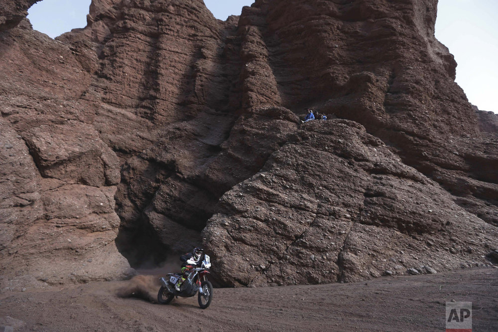 In this Jan. 11, 2016 photo, Honda rider, Argentina's Kevin Benavidez races during the eighth stage of the 2016 Dakar Rally, in Cafayate, Argentina. (AP Photo/Jorge Saenz)