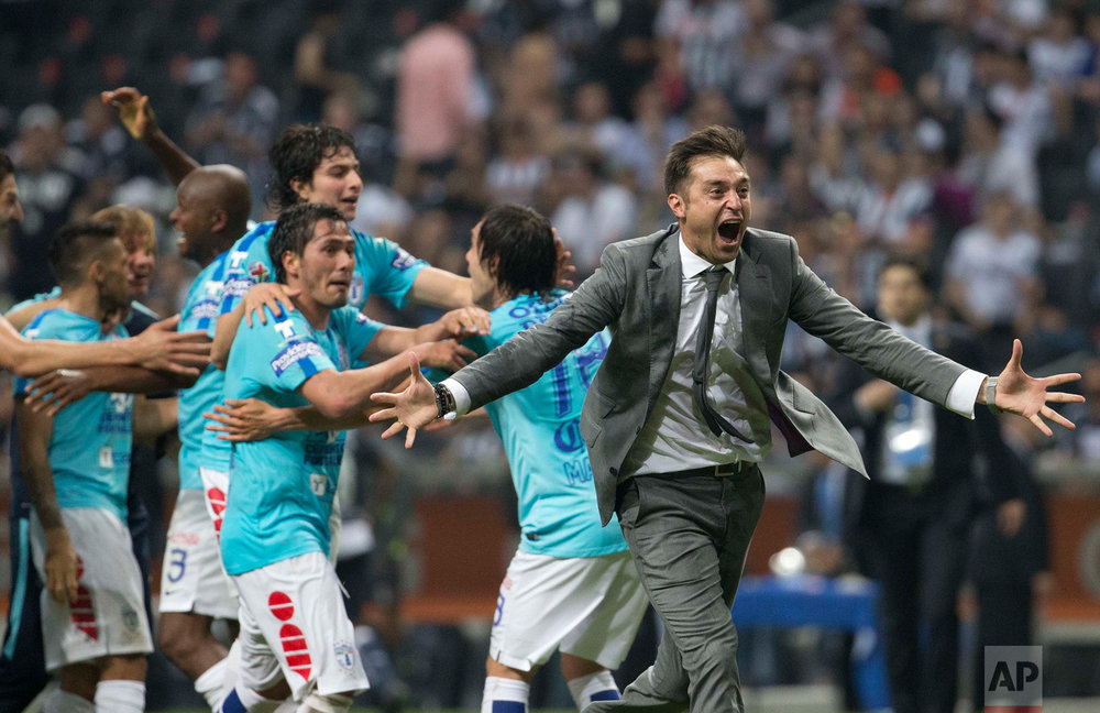 In this May 29, 2016 photo, Pachuca's coach Diego Alonso, right, celebrates after defeating of Monterrey and crowning themselves champions of the Mexican soccer league, in Monterrey. (AP Photo/Eduardo Verdugo)