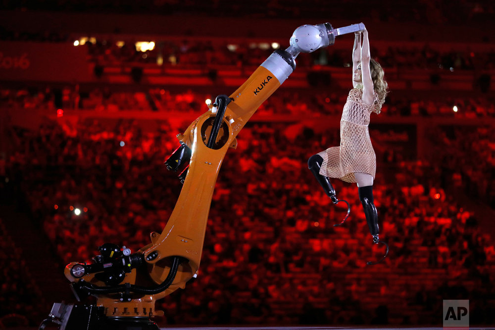 In this Sept. 7, 2016 photo, amputee Amy Purdy dances with a robot during the opening ceremony of the Paralympic Games at Maracana Stadium in Rio de Janeiro, Brazil. (AP Photo/Mauro Pimentel)