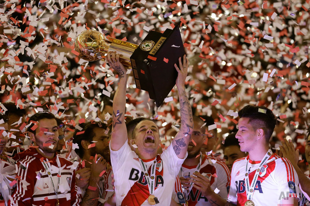 In this Aug. 25, 2016 photo, Andres D'Alessandro of Argentina's River Plate lifts the trophy after winning the Recopa Sudamericana final soccer match against Colombia's Independiente Santa Fe in Buenos Aires, Argentina. (AP Photo/Victor R. Caivano)