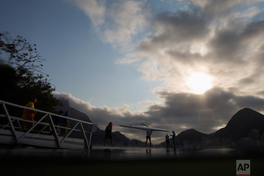 In this Aug. 9, 2016 photo, a rower carries his boat prior to competition during the 2016 Summer Olympics in Rio de Janeiro, Brazil. (AP Photo/Felipe Dana)