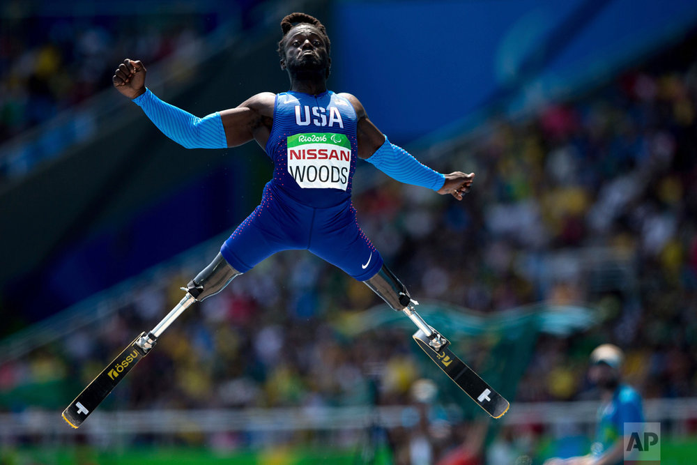 In this Sept. 17, 2016 photo, Regas Woods, of the United States, competes in the men's long jump T42 final, during the Paralympic Games, at the Olympic Stadium, in Rio de Janeiro, Brazil. (AP Photo/Mauro Pimentel)
