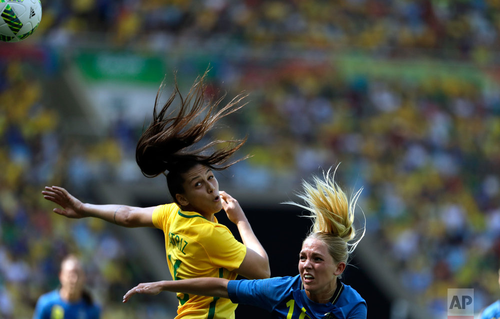 In this Aug. 16, 2016 photo, Brazil's Beatriz, left, and Sweden's Elin Rubensson go for a header during a semi-final match of the women's Olympic football tournament between Brazil and Sweden at the Maracana Stadium in Rio de Janeiro.(AP Photo/Natacha Pisarenko)