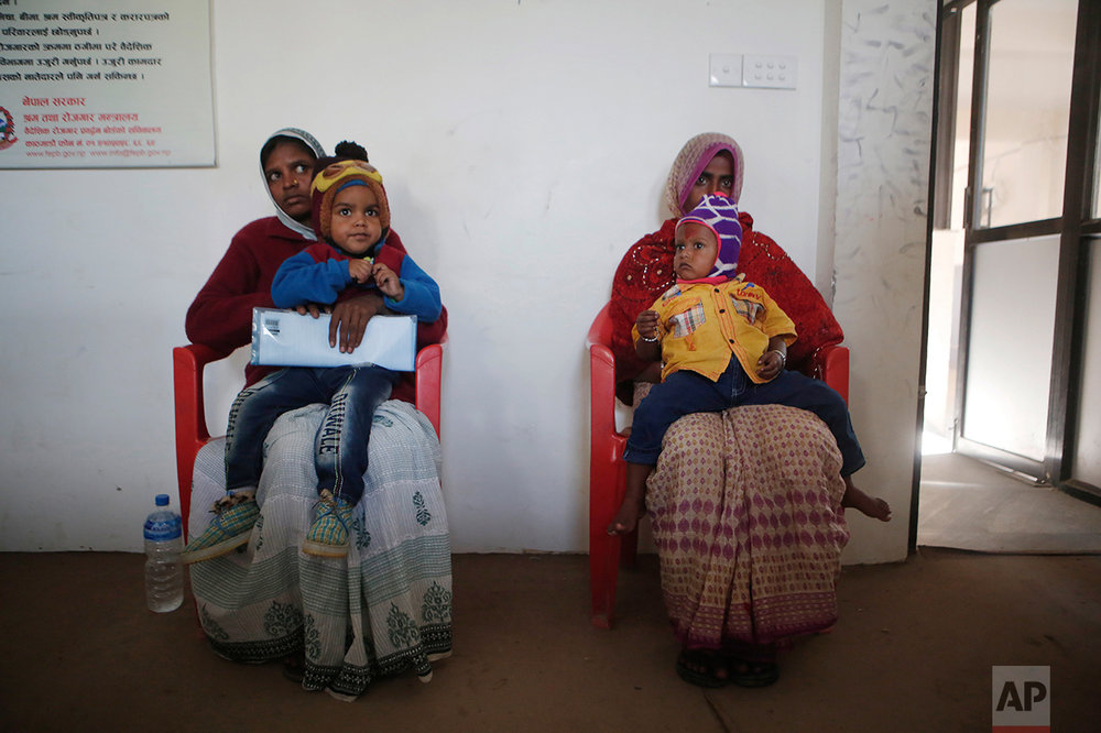 In this photo taken on Tuesday, Dec 20, 2016, Saro Kumari Mandal, 26, left, and Munni Devi, both wives of migrant workers who died in Qatar, sit with their sons on their laps as they wait at the Foreign Employment Promotion Board to receive compensation in Kathmandu, Nepal. The number of Nepali workers going abroad has more than doubled since the country began promoting foreign labor in recent years: from about 220,000 in 2008 to about 500,000 in 2015. Yet the number of deaths among those workers has risen much faster in the same period. In total, over 5,000 workers from this small country have died working abroad since 2008, more than the number of U.S. troops killed in the Iraq War. (AP Photo/Niranjan Shrestha)In this Wednesday, Nov. 23, 2016 photo, a woman breaks down after seeing the body of her son Balkisun Mandal Khatwe, a migrant worker who died in his sleep in Qatar, at Belhi village, in Saptari district, Nepal. The number of Nepali workers going abroad has more than doubled since the country began promoting foreign labor in recent years: from about 220,000 in 2008 to about 500,000 in 2015. Yet the number of deaths among those workers has risen much faster in the same period. But now medical researchers say these deaths fit a familiar pattern: Every decade or so, dozens, or even hundreds, of seemingly healthy Asian men working abroad in poor conditions start dying in their sleep. The suspected killer even has a name: Sudden Unexplained Nocturnal Death Syndrome. (AP Photo/Niranjan Shrestha)