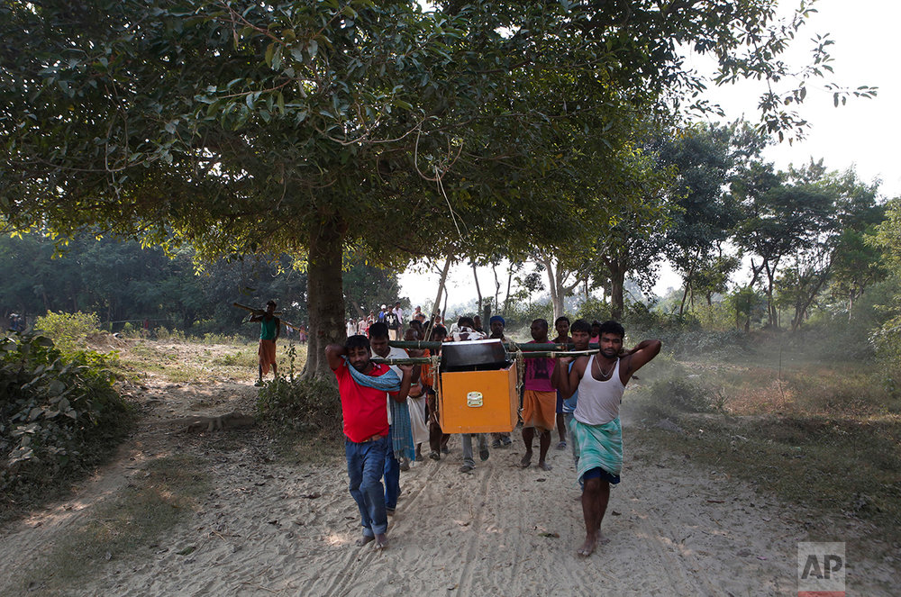 In this Nov. 23, 2016 photo, relatives and villagers carry the coffin of Balkisun Mandal Khatwe at Belhi village, Saptari district of Nepal. Balkisun, who had been working for Habtoor Leighton Group in Qatar for less than a month, died in his sleep. The number of Nepali workers going abroad has more than doubled since the country began promoting foreign labor in recent years: from about 220,000 in 2008 to about 500,000 in 2015. Yet the number of deaths among those workers has risen much faster in the same period. In total, over 5,000 workers from this small country have died working abroad since 2008, more than the number of U.S. troops killed in the Iraq War. (AP Photo/Niranjan Shrestha)