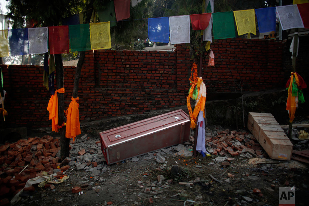 In this Monday, Nov. 29, 2016 photo, a red coffin that brought home the body of Nepali migrant worker from Saudi Arabia, lies on the ground empty after cremation rituals were completed at Swayambhunath stupa in Kathmandu, Nepal. The number of Nepali workers going abroad has more than doubled since the country began promoting foreign labor in recent years: from about 220,000 in 2008 to about 500,000 in 2015. Yet the number of deaths among those workers has risen much faster in the same period. In total, over 5,000 workers from this small country have died working abroad since 2008, more than the number of U.S. troops killed in the Iraq War. (AP Photo/Niranjan Shrestha)