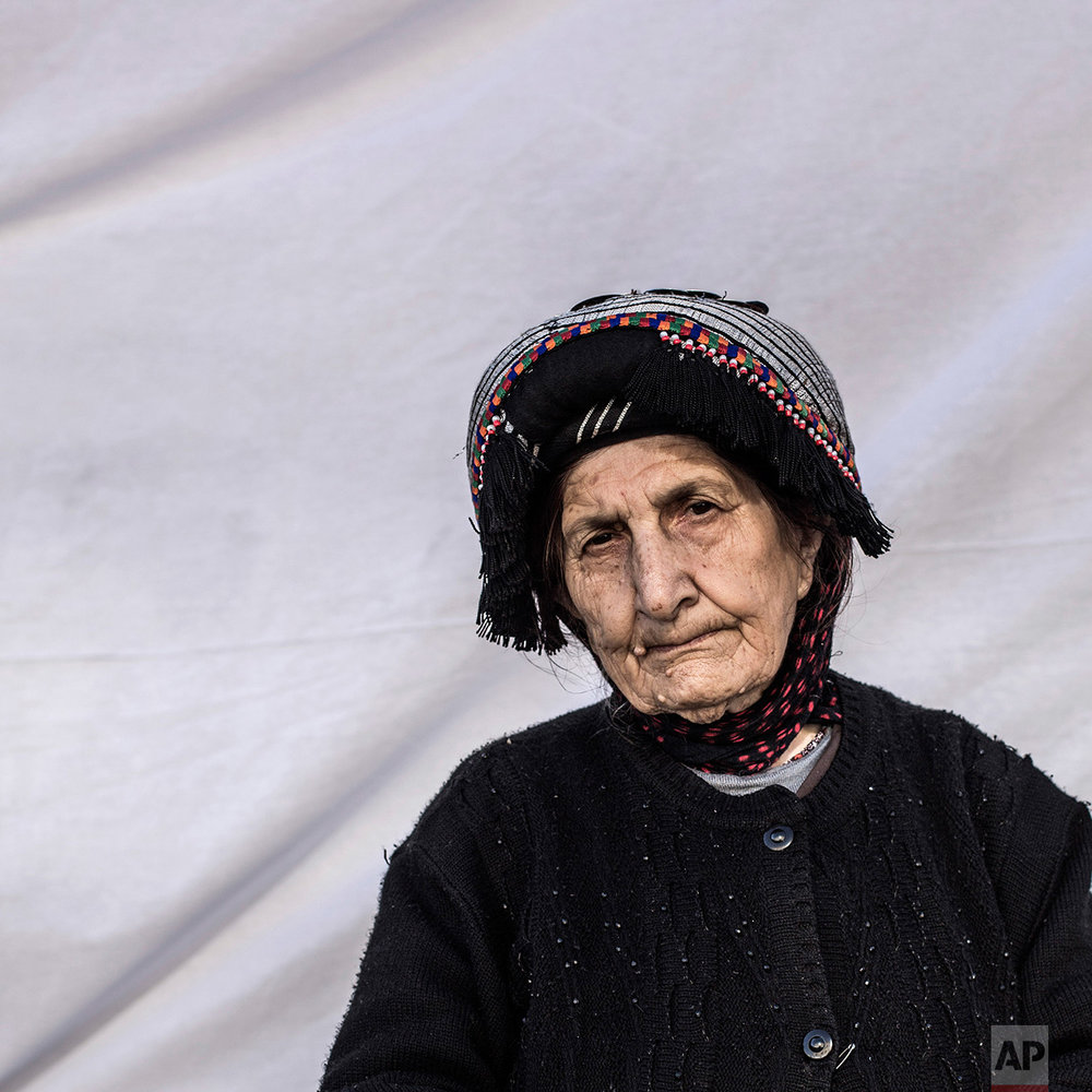 Victoria Behman Akouna, 79, poses for a portrait in the Karamlis complex, where Christians displaced by Islamic State militants are living, in Irbil, Iraq, Friday, Dec. 23, 2016. Iraq's Christians are marking the holiday in his camp for displaced people with a sense of worry and despair,  unable to return to their towns they were forced to flee two years ago by the Islamic State group's onslaught. (AP Photo/Manu Brabo)