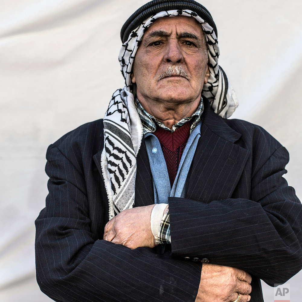 Seleman Hormz, 80, poses for a portrait in the Karamlis complex, where Christians displaced by Islamic State militants are living, in Irbil, Iraq, Friday, Dec. 23, 2016. Iraq's Christians are marking the holiday in his camp for displaced people with a sense of worry and despair,  unable to return to their towns they were forced to flee two years ago by the Islamic State group's onslaught. (AP Photo/Manu Brabo)