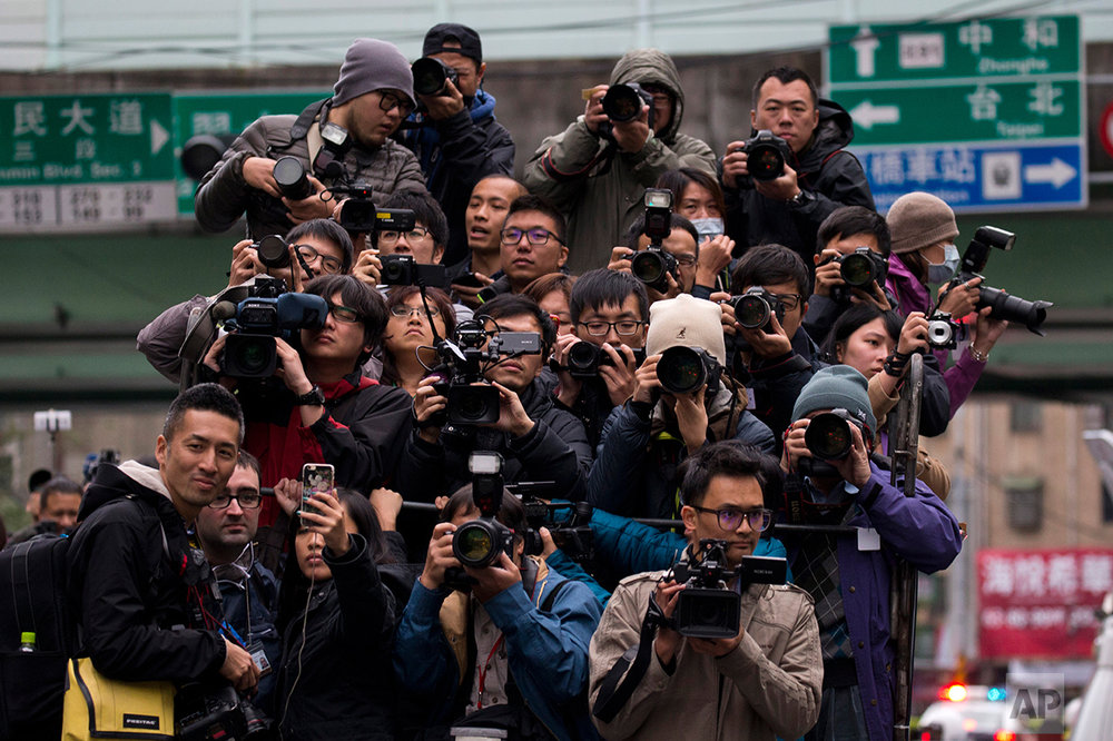 Journalists crowd onto a media truck to follow Tsai Ing-wen, presidential candidate of Taiwan's Democratic Progressive Party, as she campaigns  in Taipei, Taiwan on Wednesday, Jan. 13, 2016. Taiwan held its presidential election on Jan. 16, 2016. (AP Photo/Ng Han Guan)