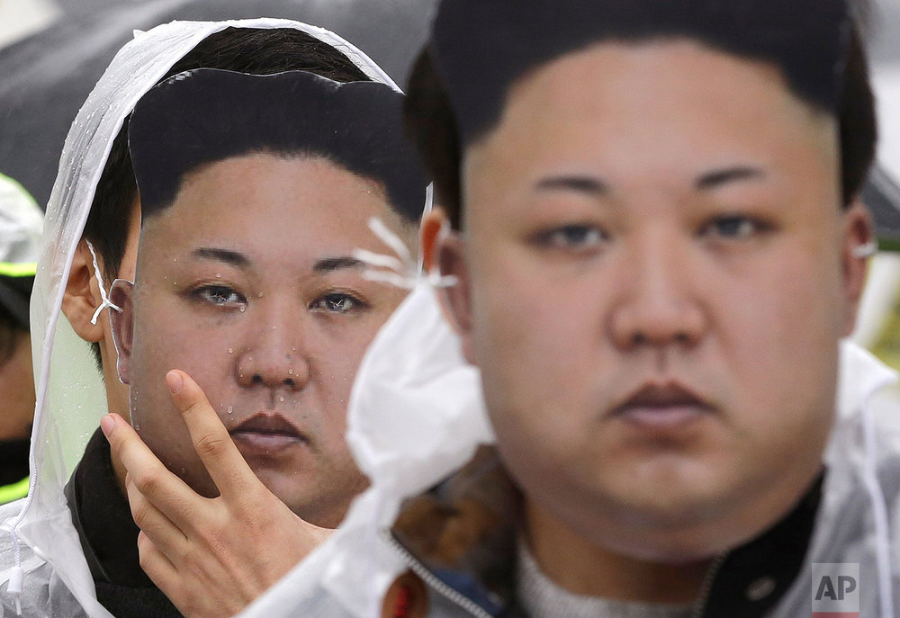 North Korean defectors wearing masks of North Korean leader Kim Jong Un attend a rally against North Korea's rocket launch and nuclear test in Seoul, South Korea, Friday, Feb. 12, 2016. (AP Photo/Ahn Young-joon)