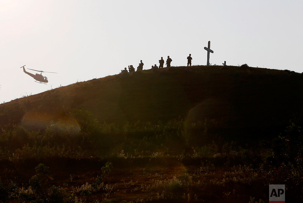 In this April 14, 2016, photo, Philippine troops man their positions on top of a hill during joint U.S.-Philippines military exercises at Crow Valley, Philippines. (AP Photo/Bullit Marquez)