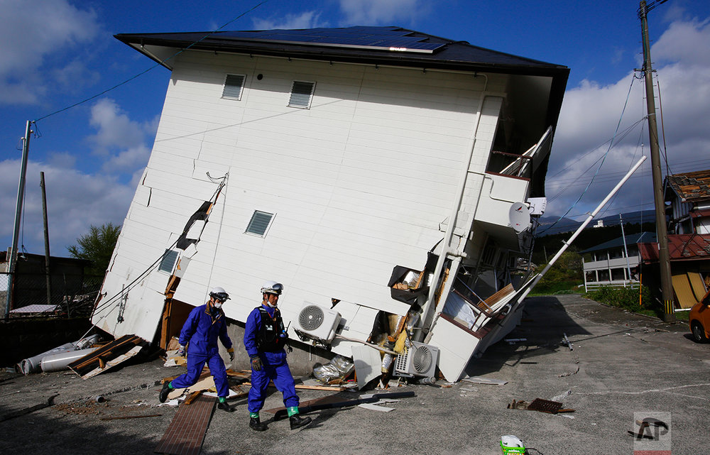 Rescuers check the damage area caused by earthquakes in Minamiaso, Kumamoto prefecture, Japan, Sunday, April 17, 2016. (AP Photo/Shizuo Kambayashi)