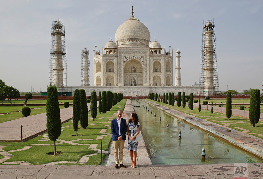Britain's Prince William, along with his wife, Kate, the Duchess of Cambridge, pose in front of the Taj Mahal in Agra, India, Saturday, April 16, 2016. (AP Photo/Saurabh Das)