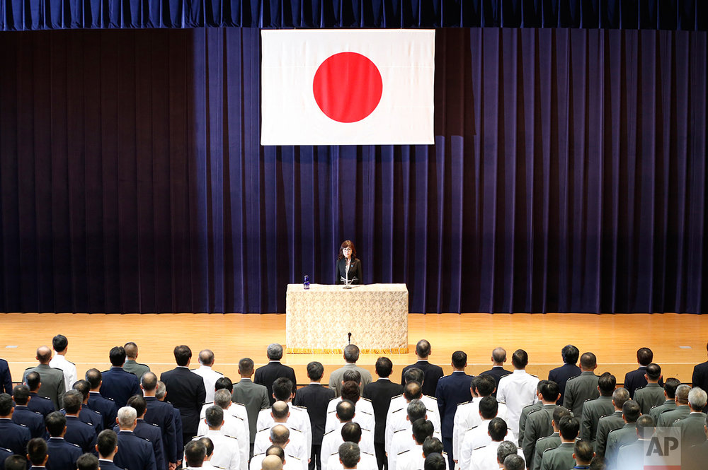 Japan's new Defense Minister Tomomi Inada delivers her inauguration speech to her staff on her first day at Defense Ministry in Tokyo, Thursday, Aug. 4, 2016.  (AP Photo/Shuji Kajiyama)