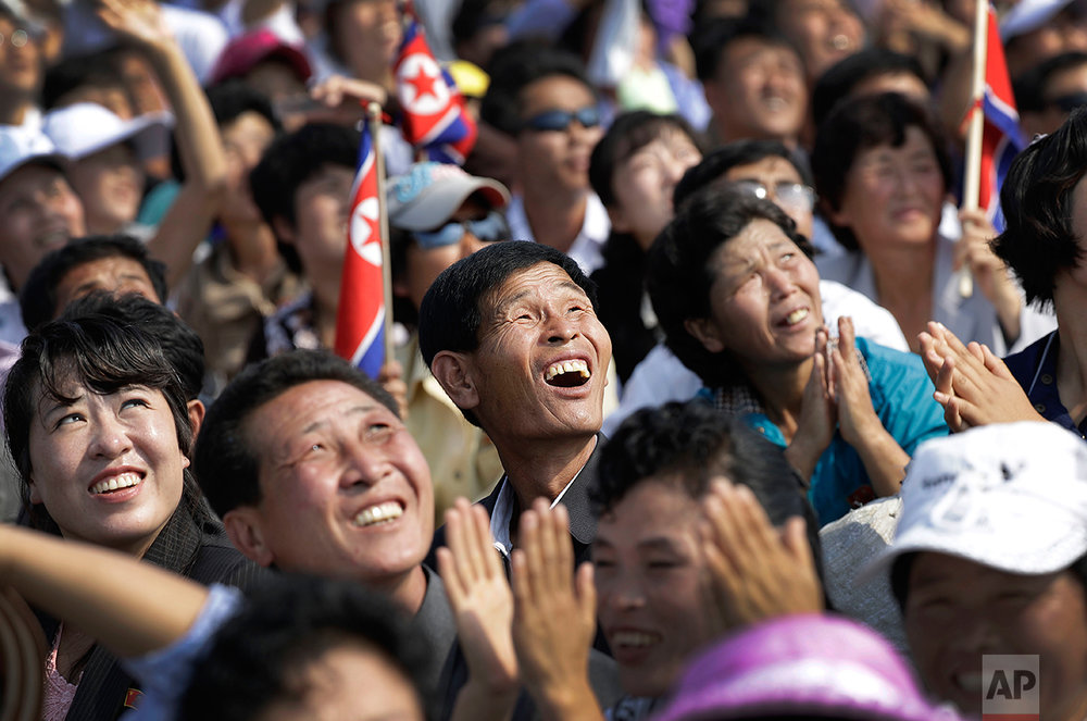 In this Saturday, Sept. 24, 2016 photo, North Koreans watch an aerial display in Wonsan, North Korea.  (AP Photo/Wong Maye-E)