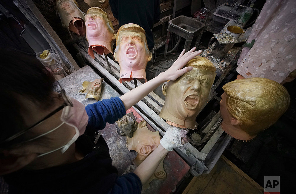 A worker moulds rubber masks depicting President-elect Donald Trump on a production line at the Ogawa Studio in Saitama, north of Tokyo, Tuesday, Nov. 15, 2016. (AP Photo/Eugene Hoshiko)