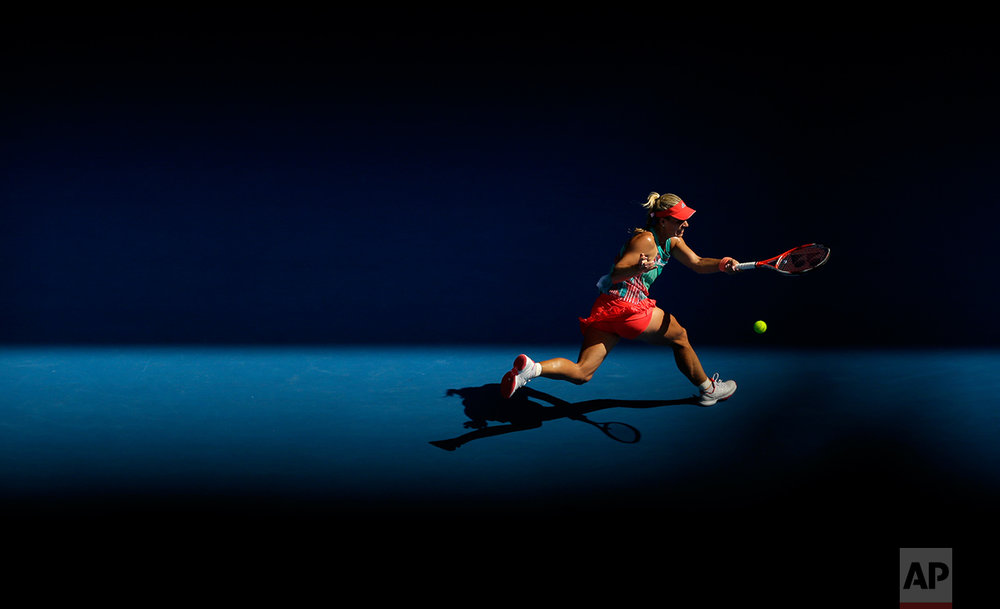 Angelique Kerber of Germany plays a forehand return to Johanna Konta of Britain during their semifinal match at the Australian Open tennis championships in Melbourne, Australia, Thursday, Jan. 28, 2016. (AP Photo/Aaron Favila)