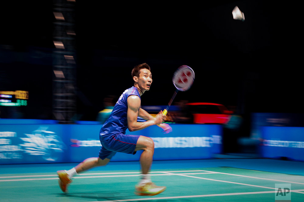 Lee Chong Wei of Malaysia returns a shot to Viktor Axelsen of Denmark during their men's singles quarter final match at the Malaysia Open Badminton Superseries in Shah Alam , Malaysia, Friday, April 8, 2016. (AP Photo/Joshua Paul)