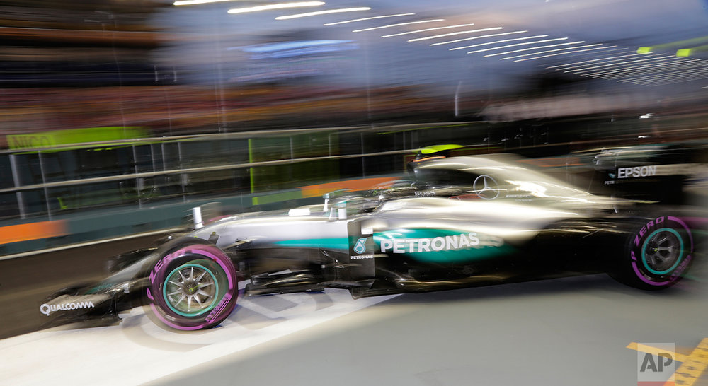 Mercedes driver Nico Rosberg of Germany steers his car out of his team garage during the third practice session for the Singapore Formula One Grand Prix on the Marina Bay City Circuit Singapore, Saturday, Sept. 17, 2016. (AP Photo/Wong Maye-E)