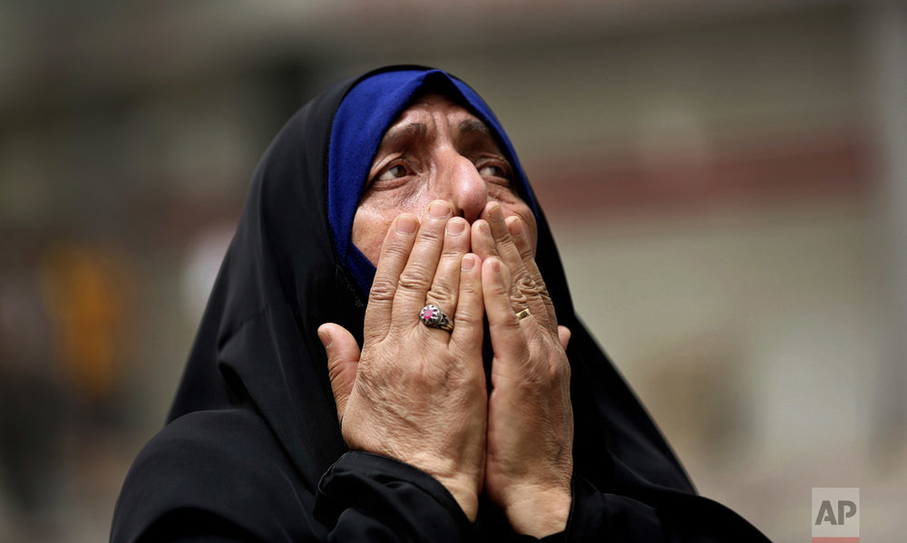 An Iraqi woman grieves at the scene after a truck bomb attack in Karradah, a busy shopping district in the center of Baghdad, Iraq on July 3, 2016. (AP Photo/Hadi Mizban)