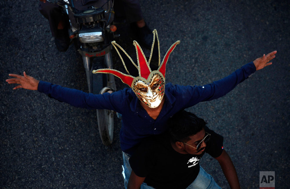 A Pakistani Christian wears mask while participating in a peace rally in connection with a Christmas celebration, in Karachi, Pakistan, Wednesday, Dec. 21, 2016. Although Pakistani Christians are in the minority, Christmas is a national holiday and is observed across the country as an occasion to celebrate. (AP Photo/Shakil Adil)