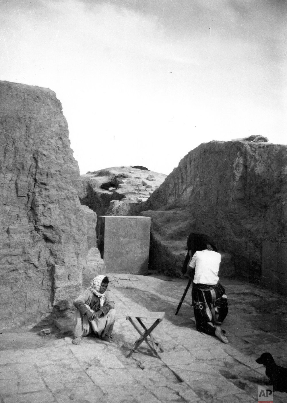 Barbara Parker taking a photograph at Nimrud